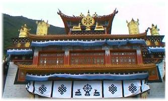 Nanwu Monastery, Kangding. On the roof can be seen the Eight Spoked Golden Wheel representing The Noble Eightfold Path and is also referred to as The Wheel of Dharma.