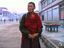 This Tibetan Buddhist nun also worked in the town digging roads, perhaps as community service or for pay.  Ganzi, Sichuan.