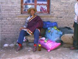 This Khamba had come to Ganzi on a shopping spree and had bought himself a fancy new chuba (coat). Ganzi, Sichuan.