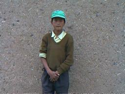 Younger Tibetans such as this 16 year old, speak both languages fluently.