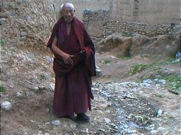 """""""The road to Sichuan is harder to travel than the road to Heaven"""" wrote the Tang poet, Li Bai. To this monk on the main path to Ganzi Lamasery, Sichuan, it must be all the same."""