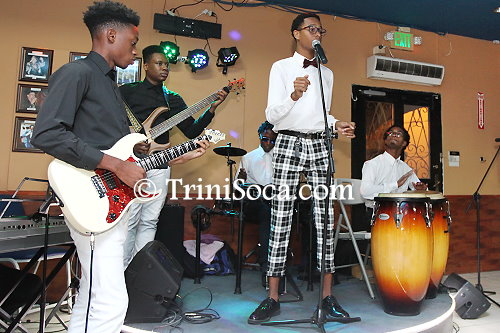 Reigning Junior Calypso Monarch Duane Ta'zyar O'Connor and the band Steem