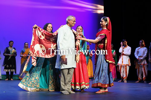 Mr. Vishnu Musai receives the shawl of honour during an Angwastram ceremony