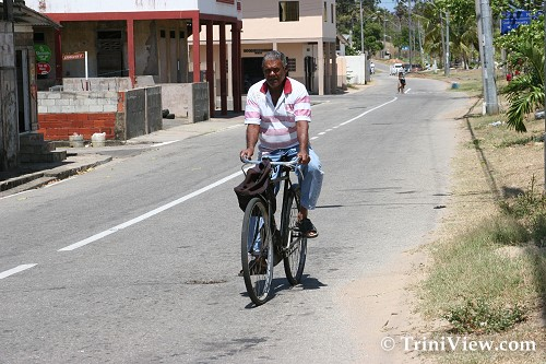 Riding along the main road in Bonasse Village, Cedros