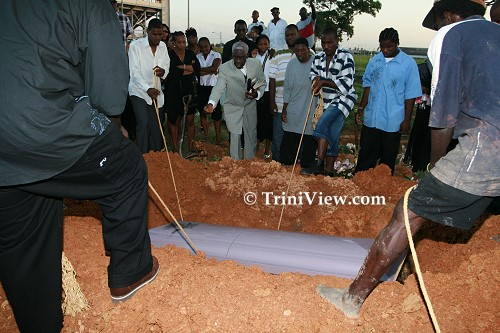 Lowering the casket into the grave