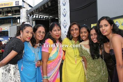 Patrons elegantly dressed in Indian apparel