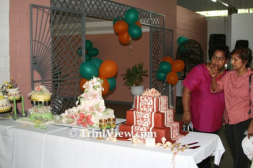 Patrons Looking At Fancily Decorated Wedding Cakes