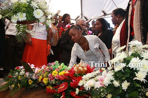 Placing wreaths on Jizelle's grave
