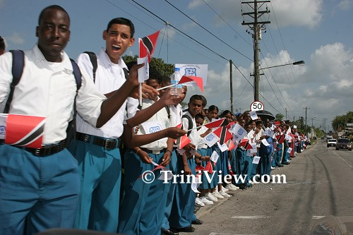 Schoolchildren lined the streets leading to the cemetery
