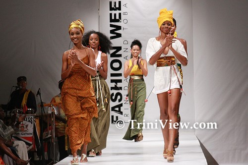 Designer Anya Ayoung-Chee (C) and models in Pilar wear