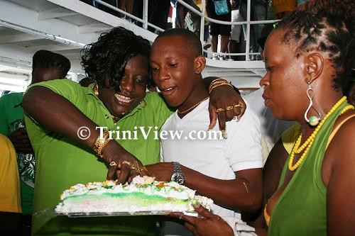 LEFT: Peggy-Ann Edwards and Christian John share a birthday cake
