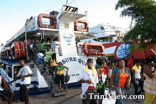 Passengers disembark the Treasure Queen at Pier 2 docks Chaguaramas