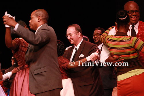 CENTER: UDeCOTT executive chairman Calder Hart and other guests dance on the stage