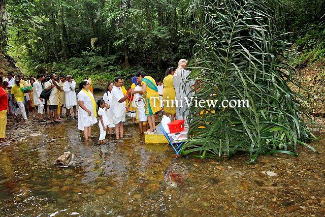 Hindus receive raksha sutra thread of protection at the Ganesh mandir