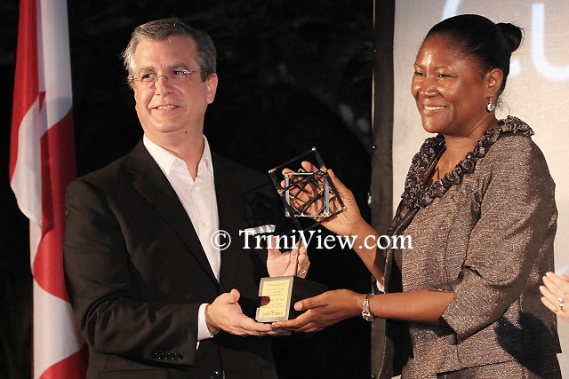 Robert Sowah, Founder and CEO of idoodlesoftware inc. presents the first ever Cubes in Space Award to Northgate College Director, Yoland La Pierre