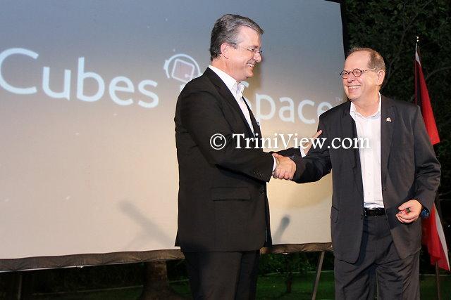 Mr. Robert Sowah, CEO of idoodlesoftware inc., presents token of appreciation to His Excellency Gérard Latulippe