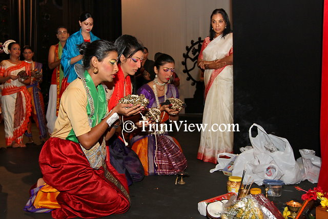 Members of the Nrityanjali Theatre participate in a puja before the show