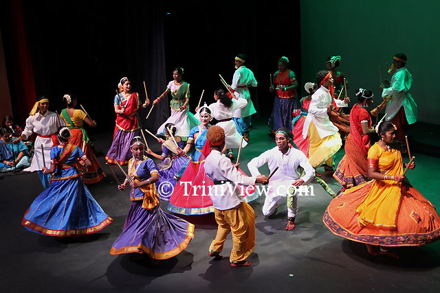 Dancers in colourful costumes celebrate the victory of good over evil and thank the Goddess by dancing the Dandia Rasa