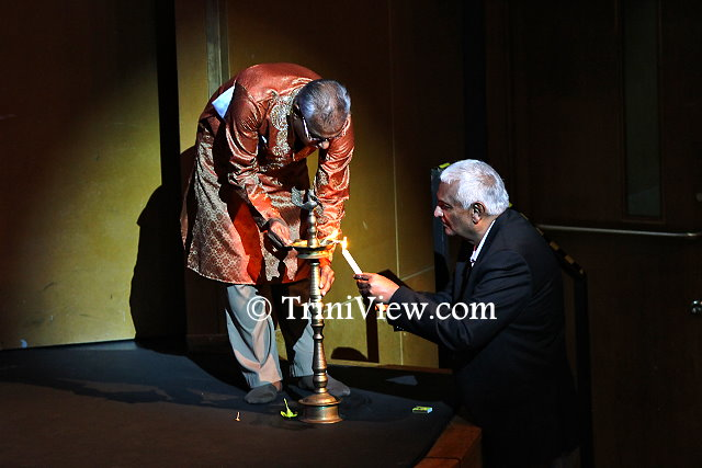 (R): Minister of Foreign Affairs Winston Dookeran joins Mr. Vishnu Musai, Chairman of the Nrityanjali theatre in the lighting of the lamp