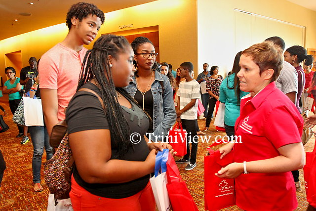 (L) Kezia Huggins, Haydon George and Markaisha De Four chat with Debra Boyce, Senior Trade Commissioner, with the High Commission of Canada to Trinidad and Tobago
