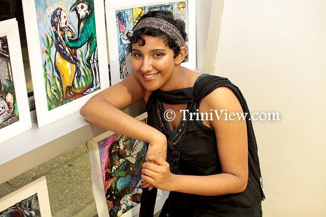 Artist, Maya Ramesar displays some of her paintings