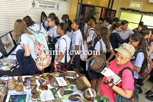Students of the Maple Leaf International School checking different species on display from UWI's zoology museum