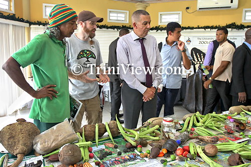 (3rd from left)...His Excellency Anthony Carmona during a brief tour at the base camp