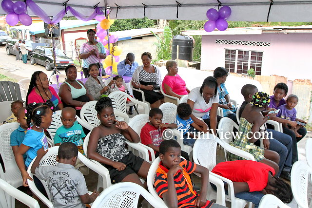 Residents of Scorpion Alley, Carenage at the Christmas get-together