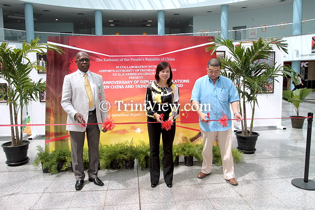 General Operations Manager of Piarco International Airport Oswald Bruce, Counsellor of the Chinese Embassy Ms. Lan Heping, and Managing Director of Shanghai Construction Group International Michael Zhang cut the ribbon officially launching the exhibition