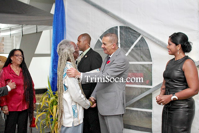 President Anthony Carmona and his wife, Reema Carmona greet veteran calypsonian Emerald 'Brother Valentino' Phillip