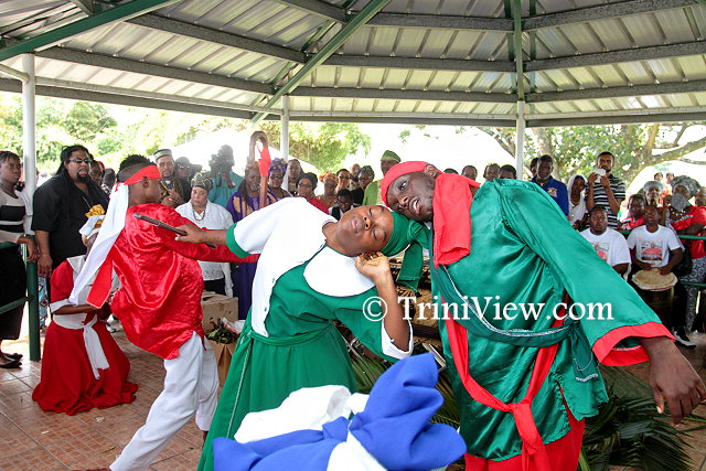 A performance in memory of Junior Noel at the Caroni Cremation Site