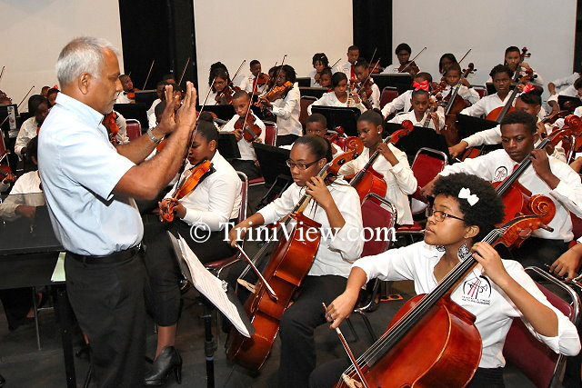 Venezuelan Head Tutor, Mr. Heemath Jahoor during rehearsals with the orchestra