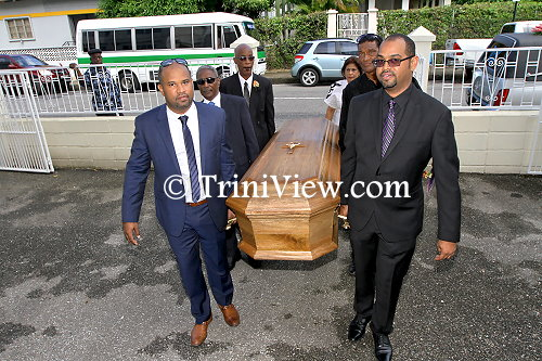 Entering the St. Theresa's R.C. Church compound, the Sons of Earl Crosby lead the pall-bearers carrying their father's casket
