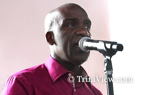 Former lead singer of Charlie's Roots, Christopher 'Tambu' Herbert sings at Earl Crosby's funeral