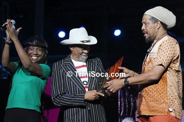 (R) Karega Mandela presents an award to Paul 'Trinidad Bill' Trotman on behalf of TUCO. (L) Shirlane Hendrickson