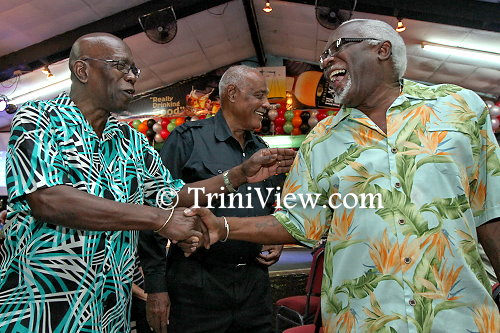 Jack Warner and Selwyn Ryan greet each other