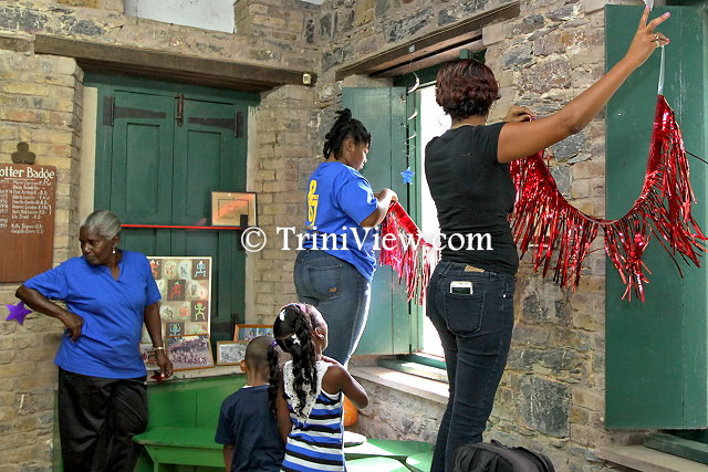 Members of Posse 67 decorating the Girl Guides Headquarters, Zoo Road, Port of Spain