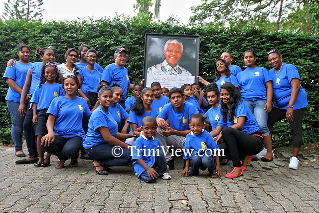 A group shot with Trinidad and Tobago Posse 67 and kids from the Trinidad and Tobago Hope Centre, San Fernando at the Girl Guides Headquarters, Zoo Road, Port of Spain