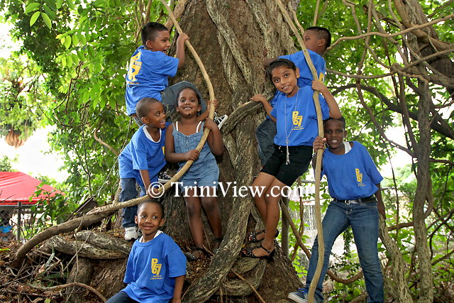 Children having fun under the tree at the Girl Guides Headquarters, Zoo Road, Port of Spain