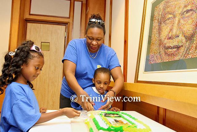 Cutting cake at the Posse 67 Nelson Mandela birthday celebration