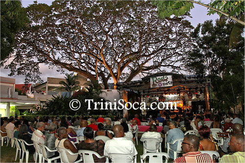 Patrons gather under the trees at Hotel Normandie for the Roots at Forty event