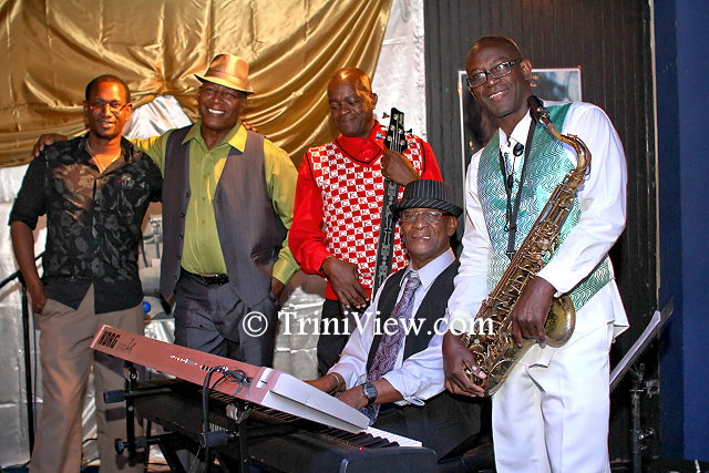 Devon Ocho, guitarist; Vonrick Maynard, drummer; Oslyn Pompie, bass player; Pelham Goddard band leader on the keyboard and saxophonist, Malcolm Boyce