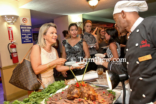 Guests being served dinner at the reception