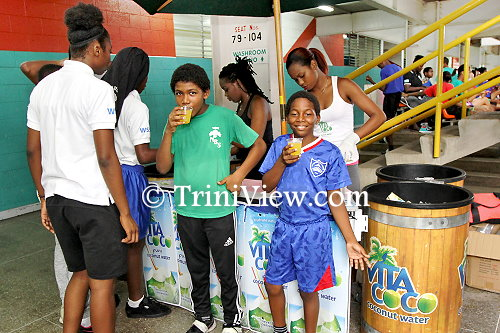 Students enjoy a glass of refreshing Vita Coco, coconut water