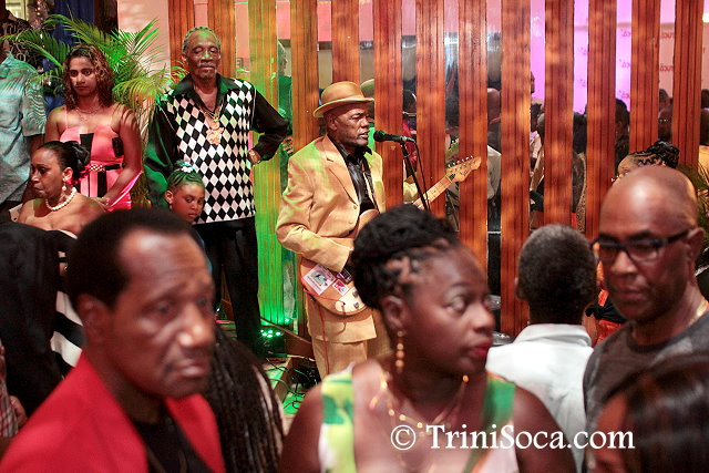 Calypsonian Neil 'Abebele' Baptiste entertains guests