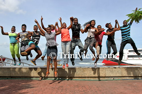Students from the New Butler Associate College having fun at the waterfront, Port of Spain before their trip to Nelson Island