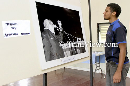 Butler's great-grandson, Christon Searles, admires an old photograph of his great-grandfather delivering one of his public speeches