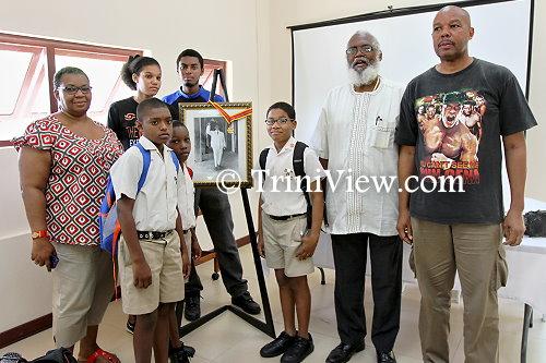 Caption: Butler's grandchildren and great-grandchildren, Bethlehem Boys R.C. students, and Professor Winston Suite (in white)