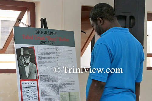 An attendee takes an interest in Butler's autobiography