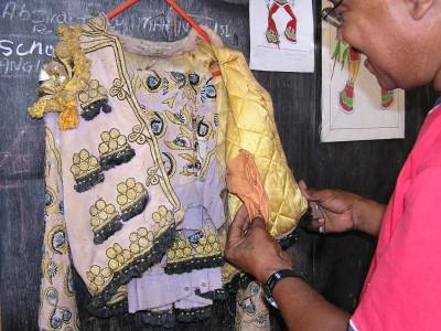 Glendon Morris displays his father's old Matador costume